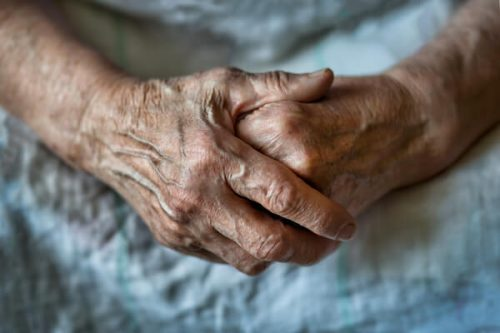bigstock-Elderly-Woman-With-Folded-Hand-269094409