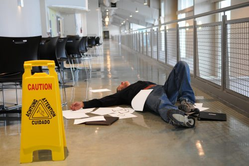 bigstock-Man-Fallen-On-Wet-Floor-25097951