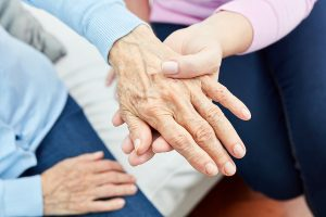 Looking at elderly hands with signs of nursing home neglect Charleston, WV